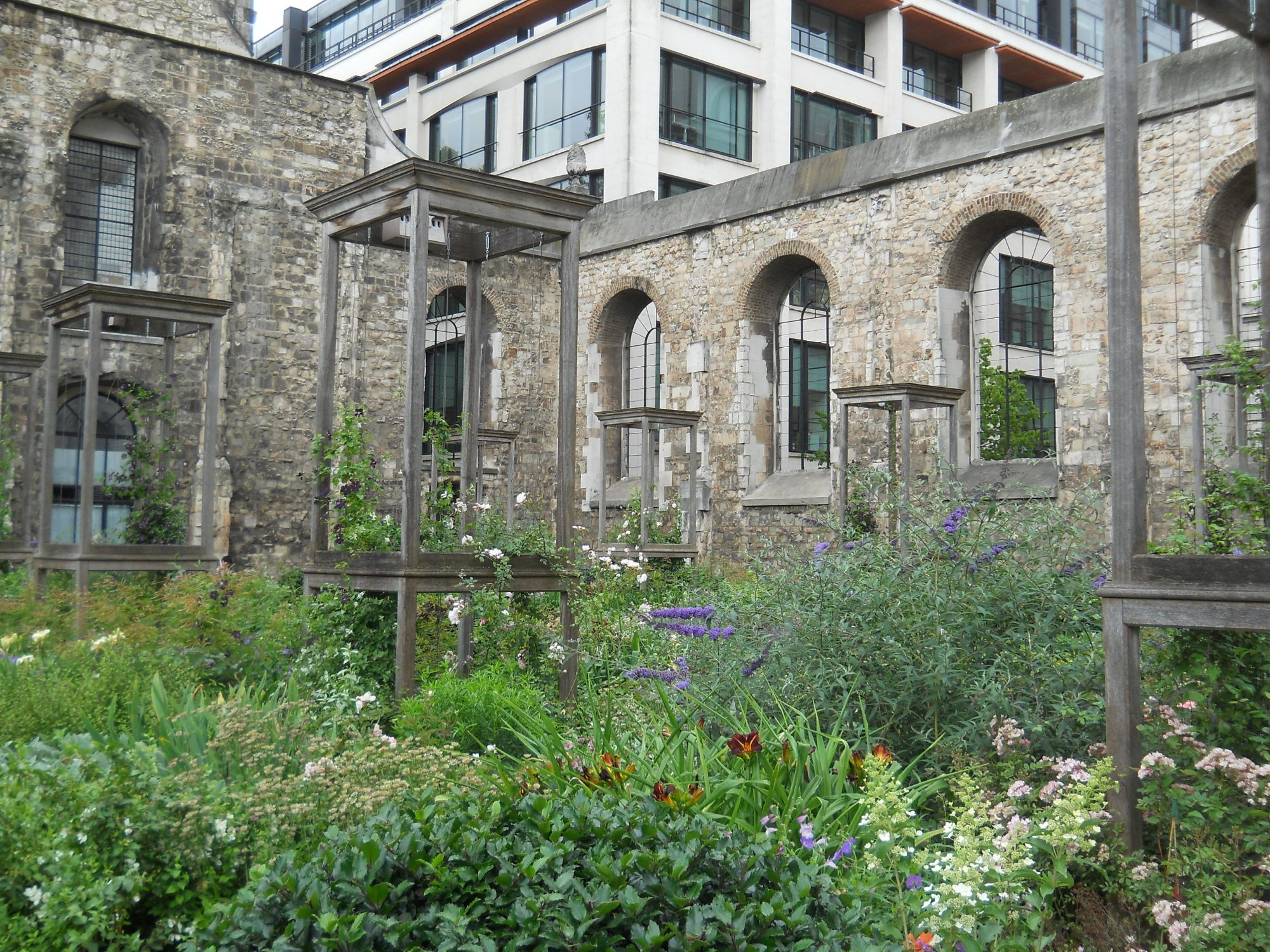 Photo of the remains of Christchurch Greyfriars. Only the tower and  walls of the former church survive and the interior has been turned into a small garden.