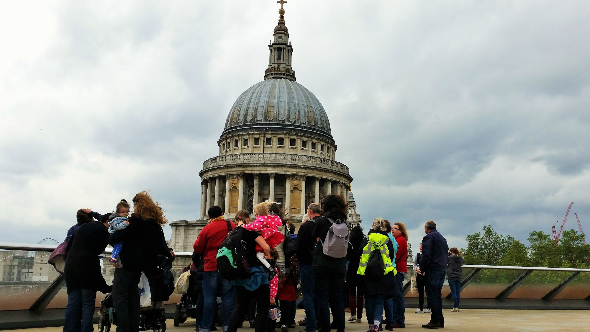 Photo of a group standing on a roof terrace and looking towards St Paul's Cathdral.