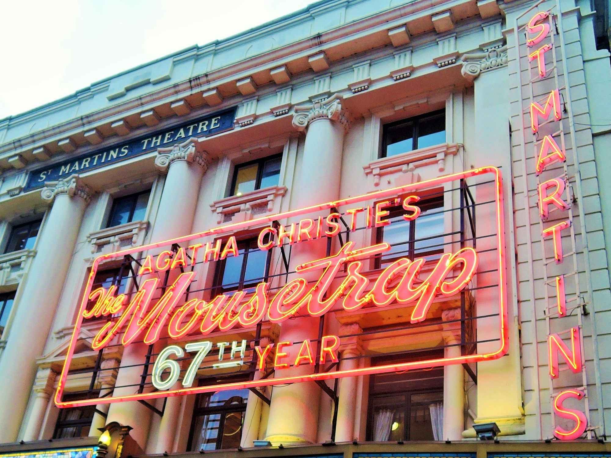 Photo of The Mousetrap's iconic, neon sign.