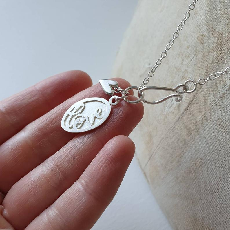 Silver Love token charm necklace