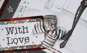 Close-up Love London handmade card with boots and tag