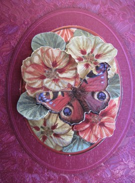 red decoupage detail of flowers and butterfly