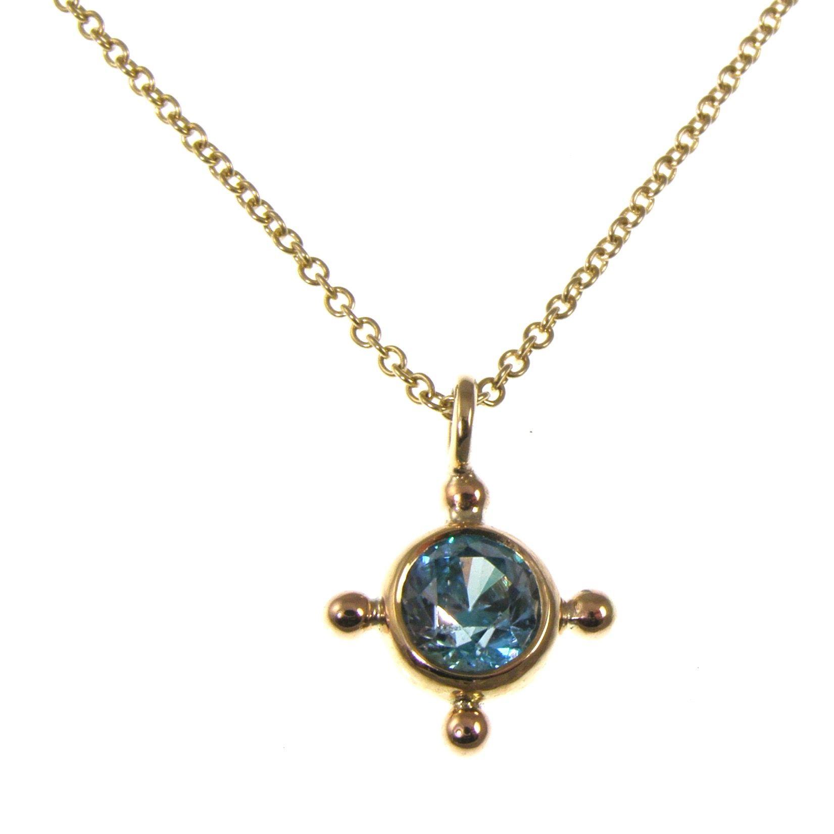 blue zircon gold pendant