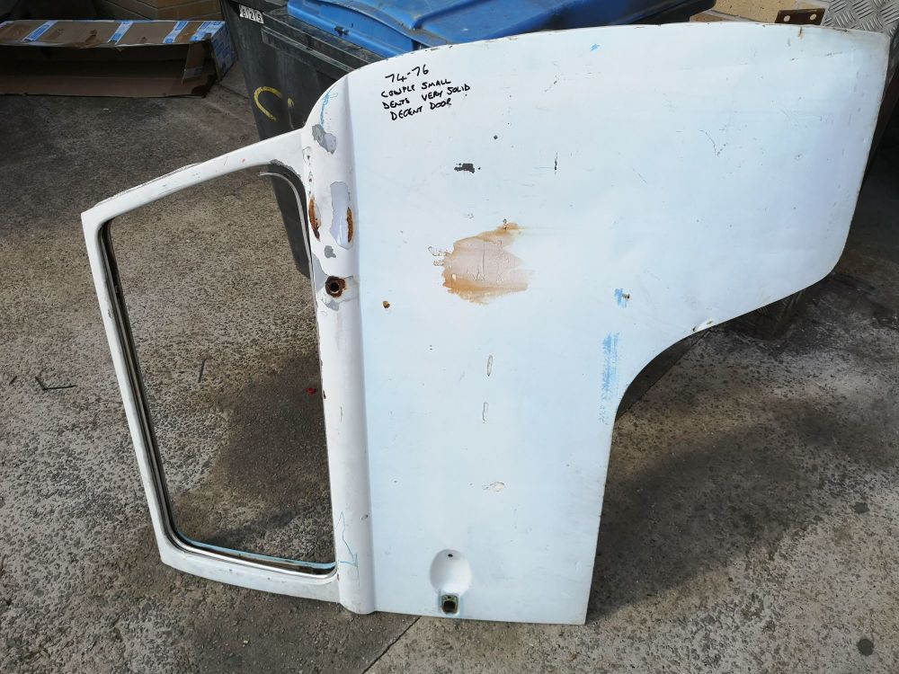 Used Cab Door 74-76, Right Side, Solid with Dents