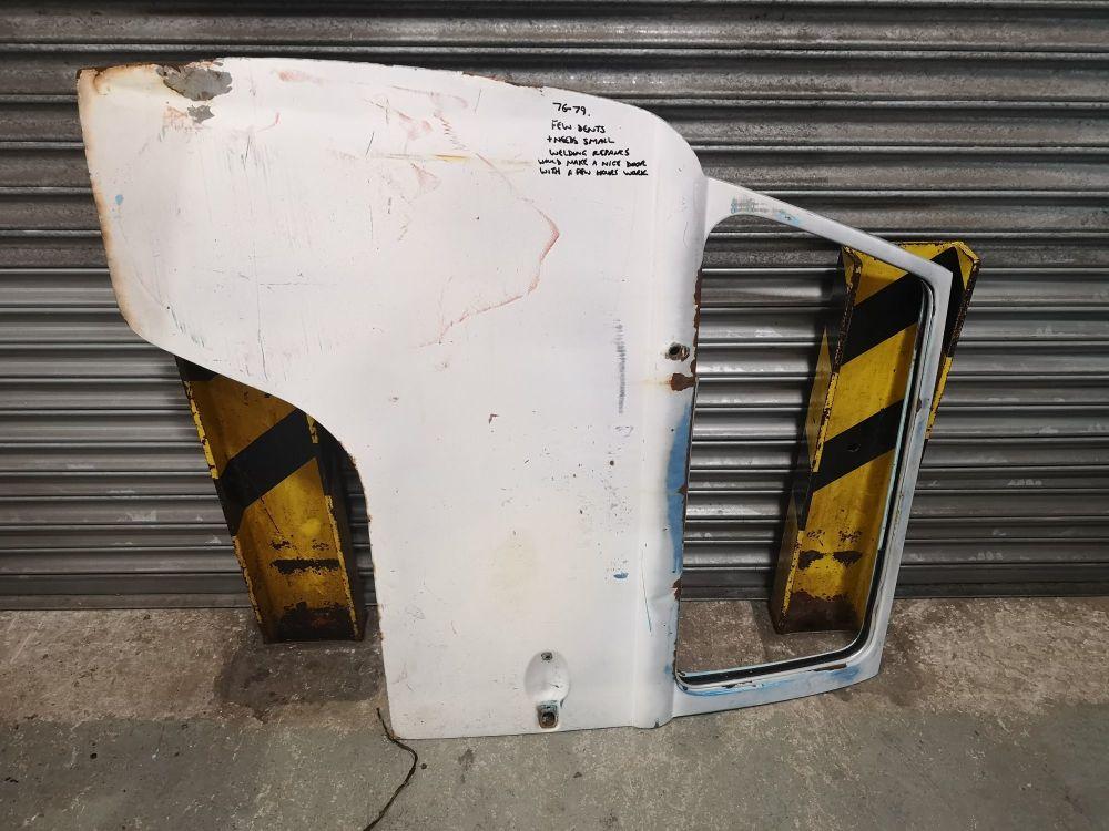 Used Cab Door 76-79, Left Side