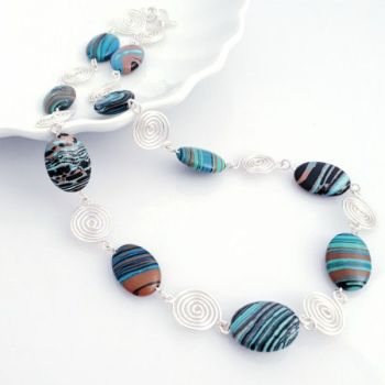 Blue Malachite and silver open spirals necklace