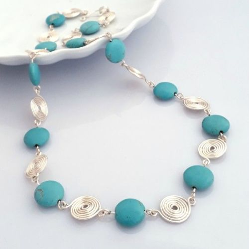 Turquoise coins and open spirals necklace