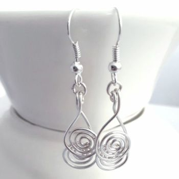 Cross over spiral earrings