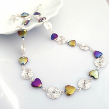 Rainbow Hematite hearts and closed spirals necklace