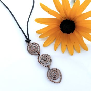 Triple spiral copper pendant