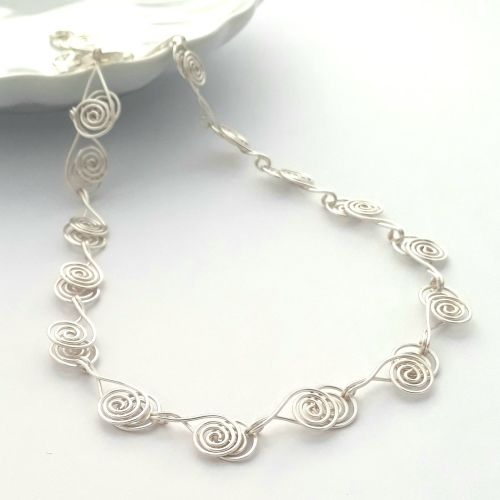 Cross over Silver Spiral necklace