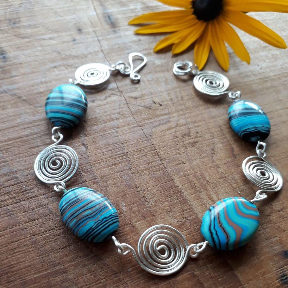 Blue stripped Malachite and silver open spirals bracelet