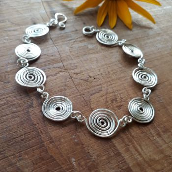 Open and Closed silver spirals bracelet
