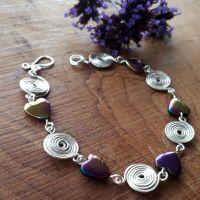 Rainbow hematite and silver spiral bracelet