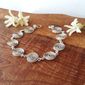 Open silver spirals bracelet