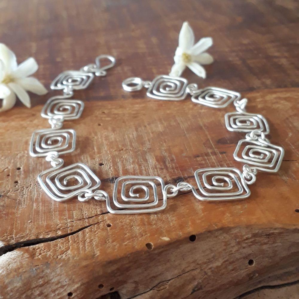 Greek key square silver spirals bracelet
