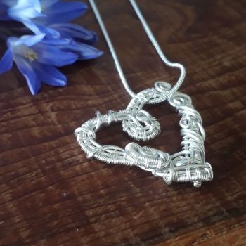 Silver wire wrapped heart pendant