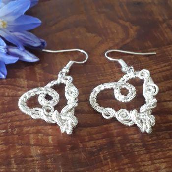 Silver wire wrapped heart earrings