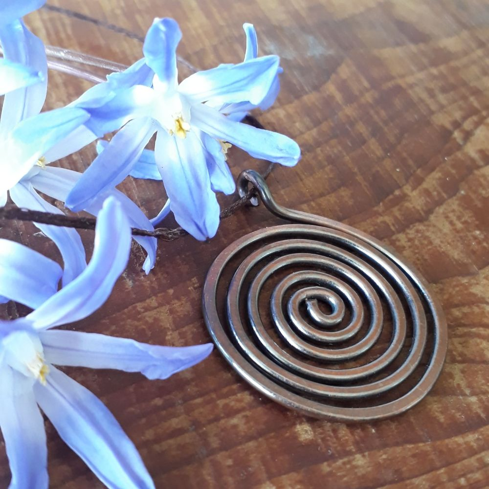 Closed copper spiral disc pendant