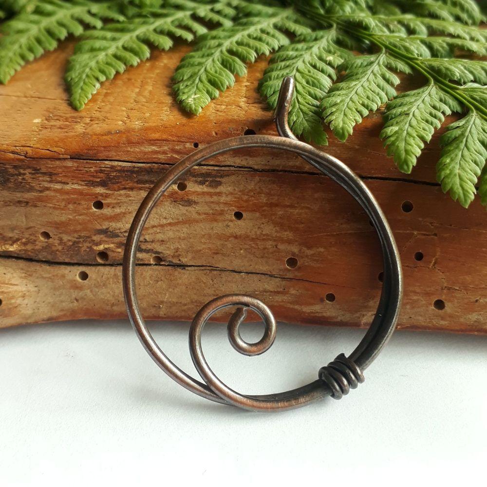 Circular copper pendant