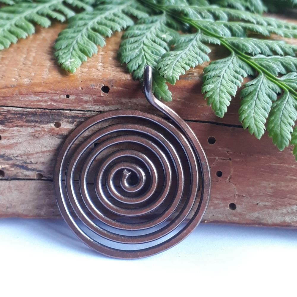 Large copper spiral disc pendant