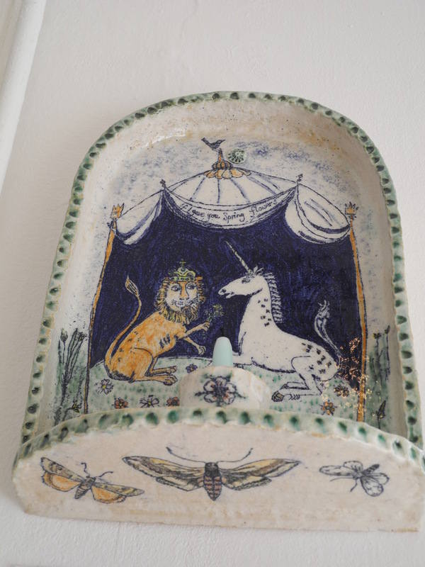 The Lion and the Unicorn. Stoneware. 30 cms high. Wall mounted niche showin