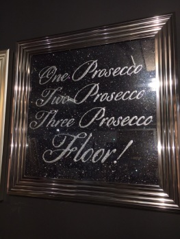 """One Prosecco two Prosecco three Prosecco four"" on Black Glitter Backing 75cm x 75cm"