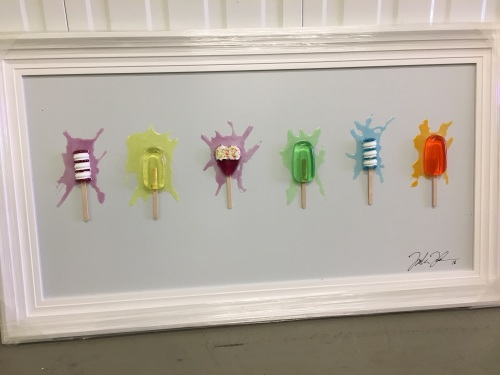 Jake Johnson 3D colourful Ice Pops wall art on a white gloss background whi