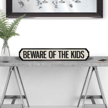 Beware of the Kids street sign