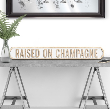 Raised on Champagne Street sign in Gold