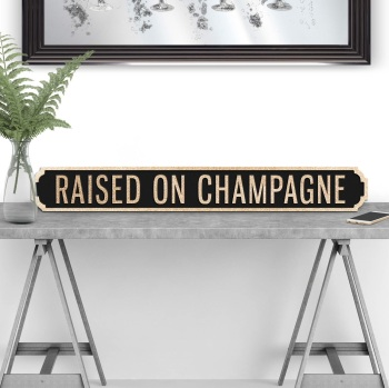 Raised on Champagne Street sign in Black & Gold