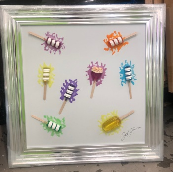 Jake Johnson 3D colourful Ice Pops wall art on a white gloss background in a chrome stepped  frame