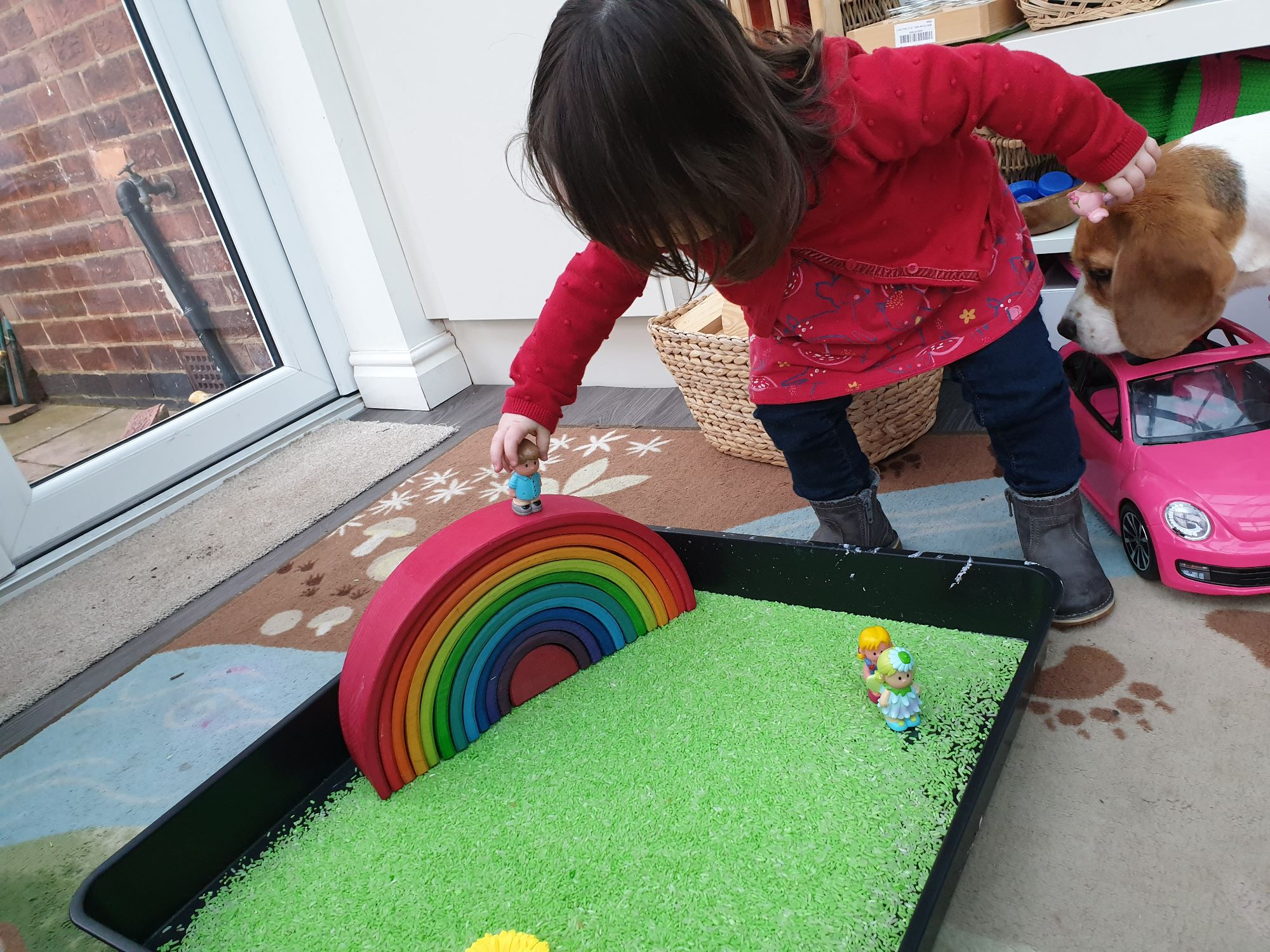 Sensory play with rice and grimms rainbow