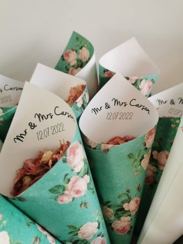 Personalised green and pink floral confetti cones.