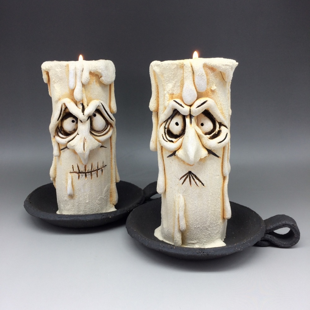 Pair of Grumpy Candle Tea Light Holders 'Dog and Magog'