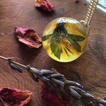 Buttercup Drop pendant on a 16 inch sterling silver chain.