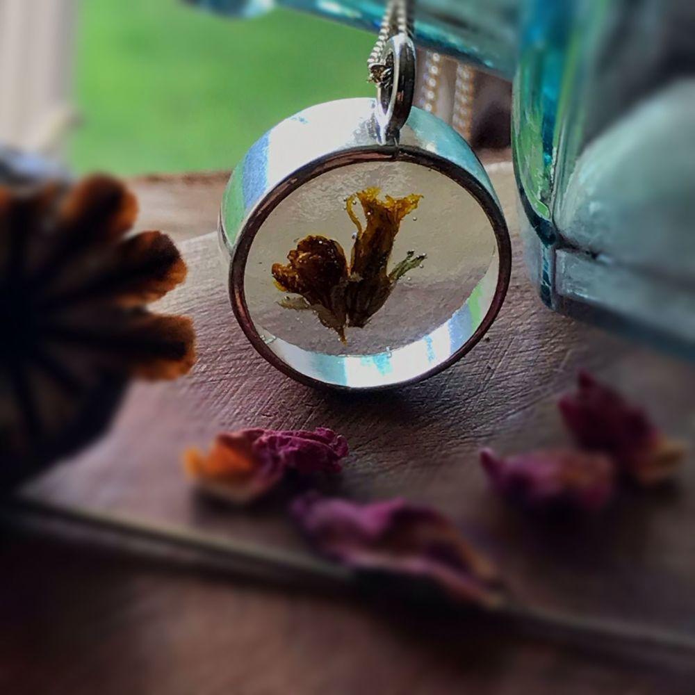 Gorse flower bezel pendant on a 16 inch sterling silver chain.