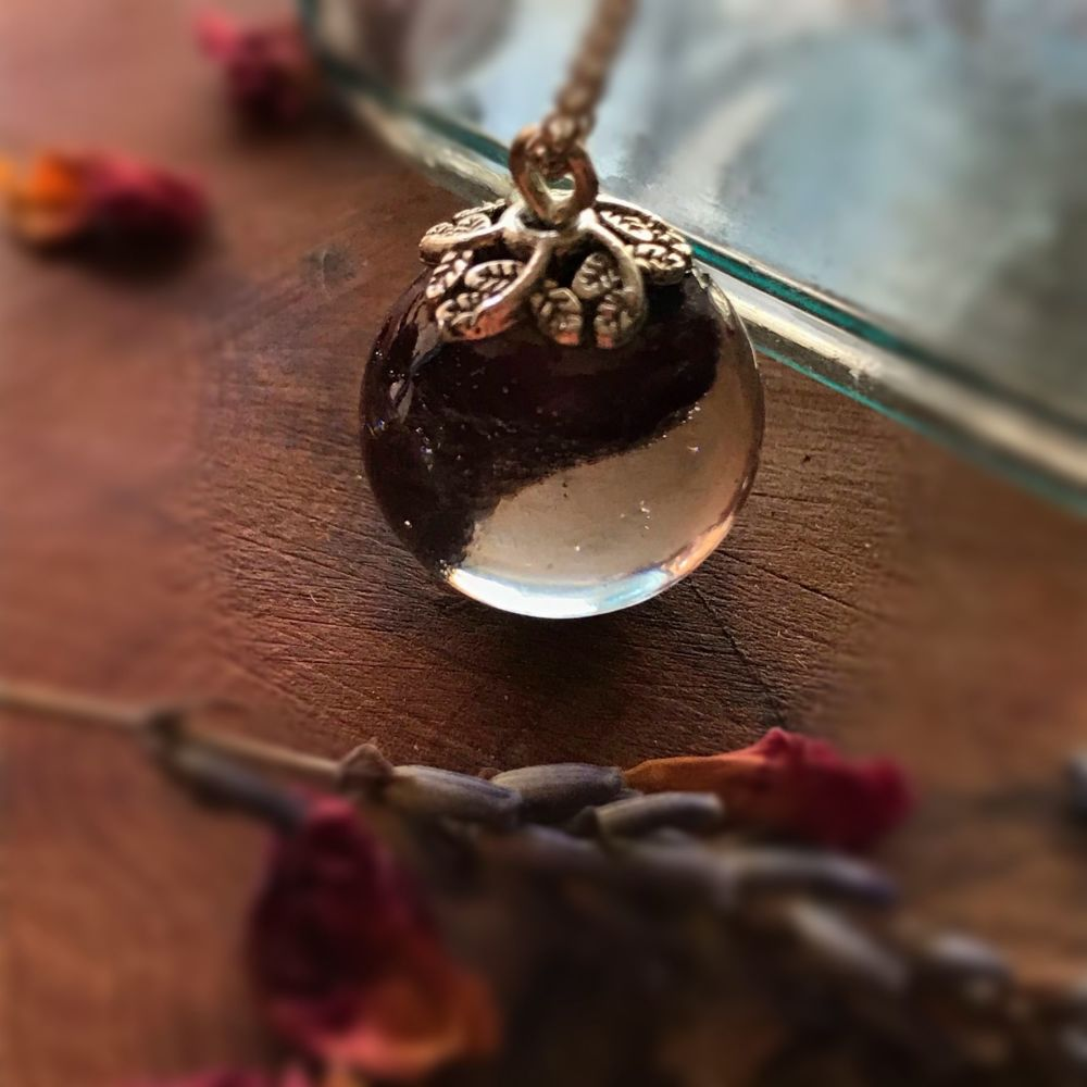 Dark red rosebud drop pendant on a 16 inch sterling silver chain.