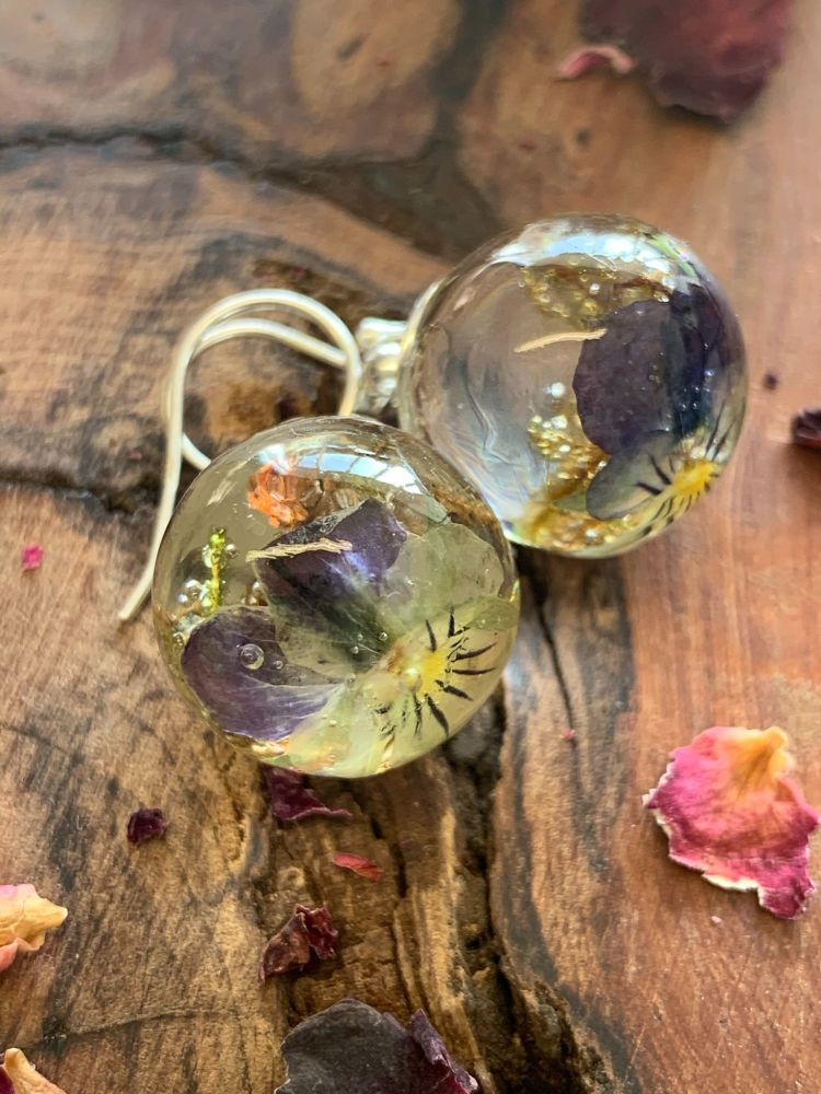 Viola and forest moss drop earrings.