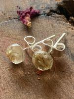 Tiny white baby's breath flower stud earrings.