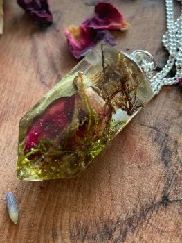 Red Rosebud and forest moss crystal point pendant on a 18 inch silver chain.