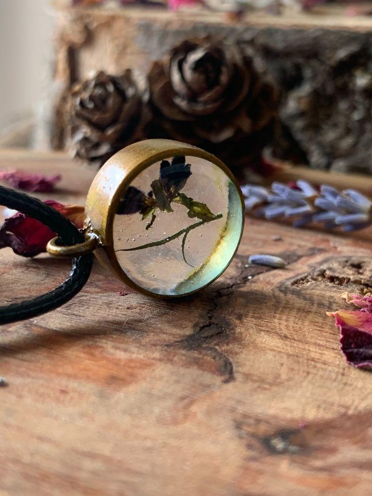 Small Wildflower bezel pendant on a 17 inch black cord necklace - Slight se
