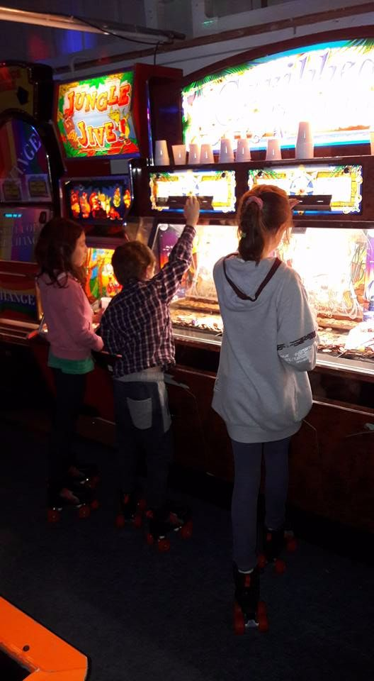 Kids playing 2p Machines at the Rink