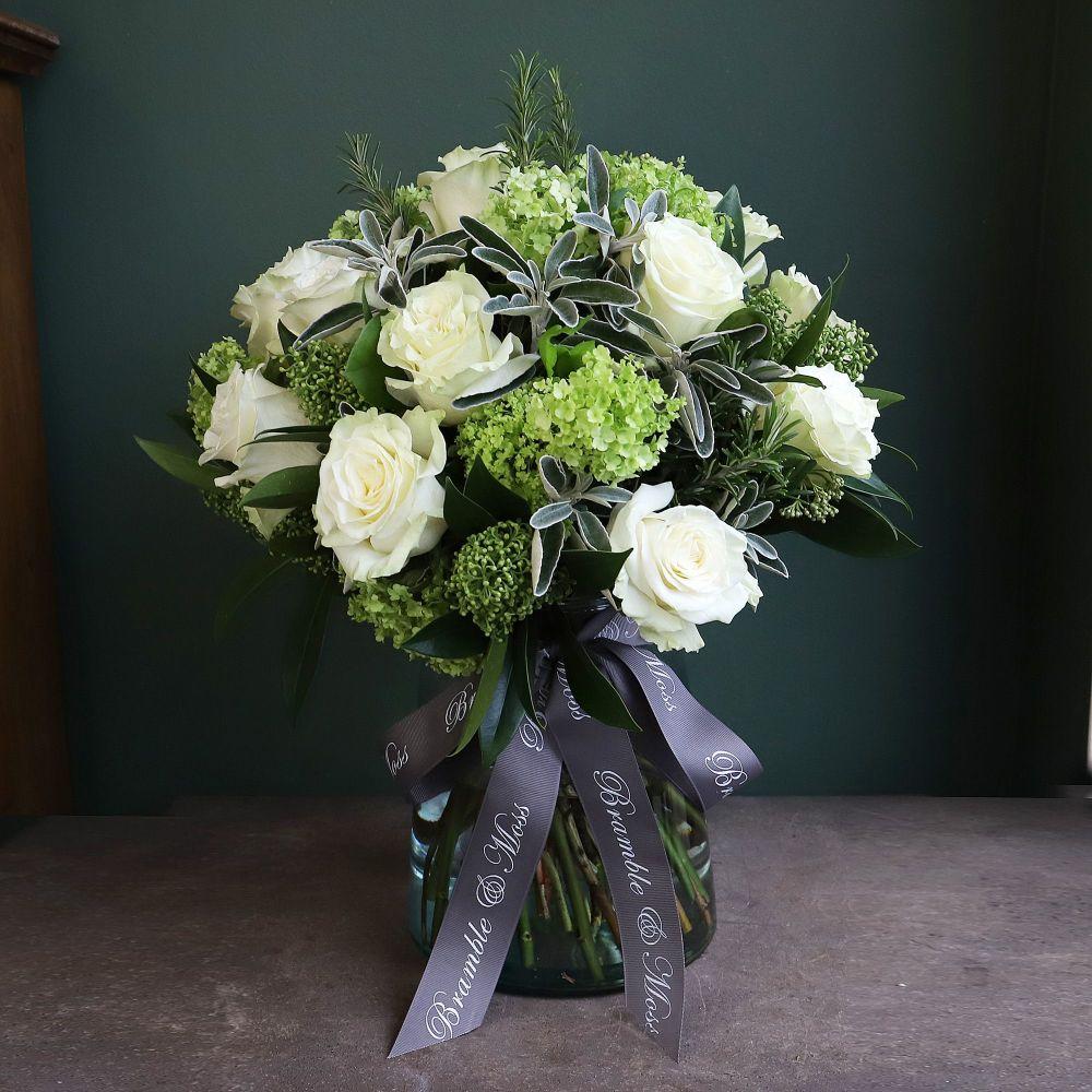 e. Two Dozen White Roses