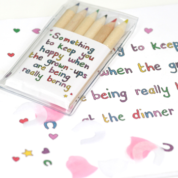 wedding book and pencils