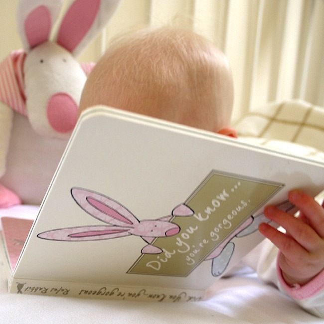 Girl Baby with Board Book by Rufus Rabbit