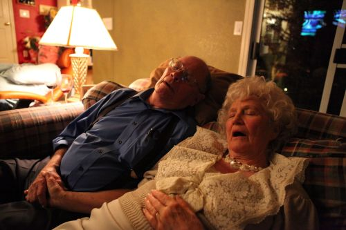 old couple sleeping after food
