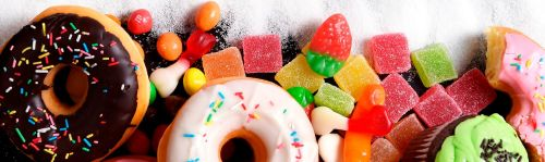 mix-of-sweet-cakes,-donuts-and-candy-with-sugar-text-000065773187_Large