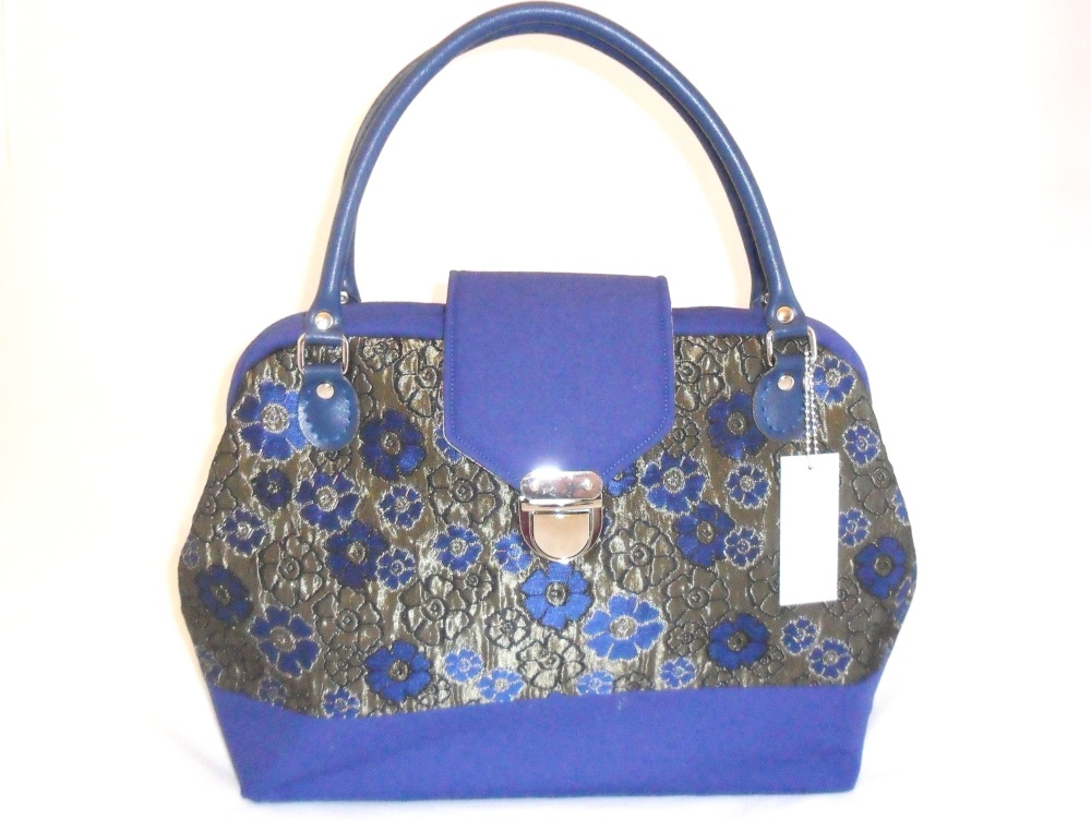 Blue and gold carpet bag