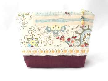Make-up bag in berry, blue and gold